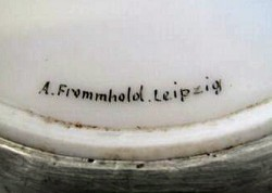 A.Frommhold. 2